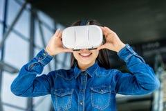 Woman wearing virtual reality glasses royalty free stock photos