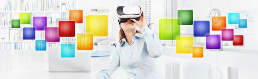 Woman wearing virtual reality glasses in office, with colors emp Royalty Free Stock Images