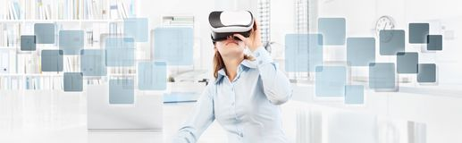 Woman wearing virtual reality glasses in office, with empty icon Royalty Free Stock Photos