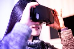Woman wearing virtual reality glasses. Smartphone using with VR headset stock photography