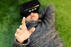 Woman wearing virtual reality glasses. Smartphone using with VR headset stock photo