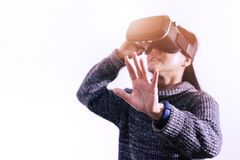 Woman wearing virtual reality glasses. Smartphone using with VR headset royalty free stock photo