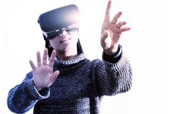 Woman wearing virtual reality glasses. Smartphone using with VR headset royalty free stock photography