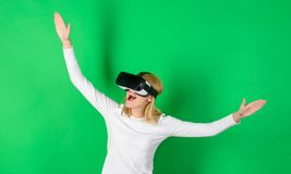 Woman wearing virtual reality goggles. Excited smiling businesswoman wearing virtual reality glasses. Person with. Virtual reality helmet isolated on green royalty free stock images