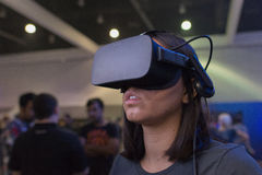 Woman wearing virtual reality goggles during VRLA Expo Summer Stock Photos