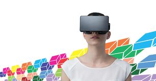 Woman wearing virtual reality headset with colorful geometric pattern. Digital composite of Woman wearing virtual reality headset with colorful geometric pattern stock photo