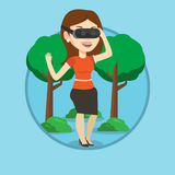 Woman wearing virtual reality headset in the park. Royalty Free Stock Photography