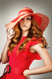 Woman wearing vogue red hat and dress Stock Image