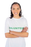 Woman wearing volunteer tshirt with arms crossed Stock Images