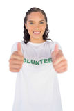 Woman wearing volunteer tshirt and giving thumb up Royalty Free Stock Photography