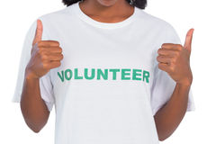 Woman wearing volunteer tshirt and giving thumbs up Royalty Free Stock Photos