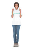 Woman wearing volunteer tshirt giving thumbs up Stock Image