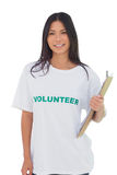 Woman wearing volunteer tshirt holding clipboard Stock Photo