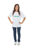 Woman wearing volunteer tshirt putting her hands on hips Royalty Free Stock Photos