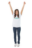 Woman wearing volunteer tshirt raising her arms Stock Photo