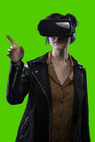 Woman Wearing VR Headset on a Green Screen Background Royalty Free Stock Photos