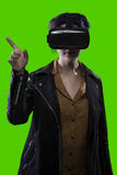 Woman Wearing VR Headset on a Green Screen Background Royalty Free Stock Photography