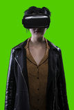 Woman Wearing VR Headset on a Green Screen Background Royalty Free Stock Image