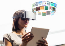 Woman wearing VR Virtual Reality Headset with Interface. Digital composite of Woman wearing VR Virtual Reality Headset with Interface Stock Photos