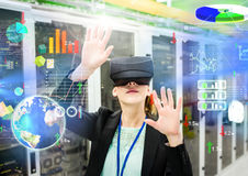 Woman wearing VR Virtual Reality Headset with Interface. Digital composite of Woman wearing VR Virtual Reality Headset with Interface Royalty Free Stock Photos