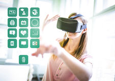 Woman wearing VR Virtual Reality Headset with Interface Health. Digital composite of Woman wearing VR Virtual Reality Headset with Interface Health Royalty Free Stock Photography