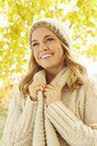 Woman Wearing Warm Clothes Under Autumn Tree Stock Image