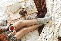 Woman wearing warm socks. Attractive woman wearing warm socks and sitting on a bed Stock Image