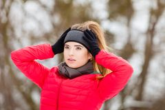 Woman wearing warm sportswear getting ready before exercising. Outdoor sport exercising, sporty outfit ideas. Woman wearing warm sportswear getting ready before Stock Images