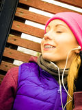 Woman wearing warm sportswear relaxing after exercising Stock Photography