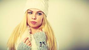 Woman wearing warm winter clothing Stock Image