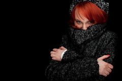 Woman wearing a warm winter hat and coat Royalty Free Stock Photo