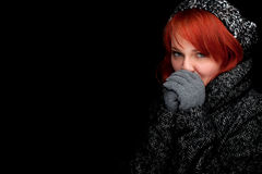 Woman wearing a warm winter hat and coat Stock Photography