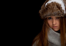 Woman wearing a warm winter hat and grey coat Royalty Free Stock Images