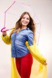 Woman wearing waterproof coat under umbrella Stock Photography