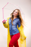 Woman wearing waterproof coat under umbrella Royalty Free Stock Photos
