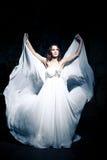 Woman wearing wedding dress Stock Photos
