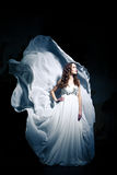 Woman wearing wedding dress Stock Photo