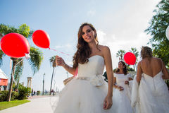 Woman wearing a wedding dress with a balloon in hand Royalty Free Stock Images