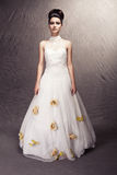 woman wearing wedding dress with flowers  Royalty Free Stock Image