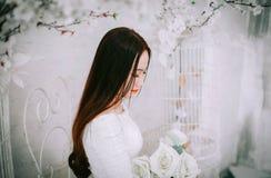 Woman Wearing Wedding Dress Holding Bouquet of Flower Stock Photos