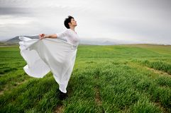 Woman wearing a wedding dress in the meadow Royalty Free Stock Images