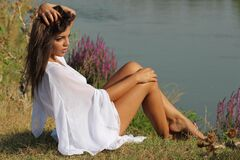 Woman Wearing White Bat Wing Top Posing Near River during Daytime Royalty Free Stock Photos