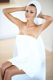 Woman Wearing White Bath Towel Drying Hair Stock Image