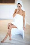 Woman Wearing White Bath Towel Sitting on Chair Stock Image