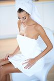 Woman Wearing White Bath Towel Sitting on Chair Stock Photo