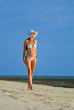 Woman Wearing White Bikini On A Vacant Beach Stock Photo