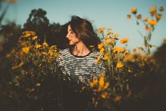 Woman Wearing White And Black Shirt Standing On Yellow Rapeseed Flower Field stock photography