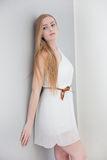 Woman Wearing White Dress Leaning Against Wall Royalty Free Stock Photos