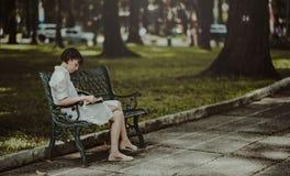 Woman Wearing White Dress Sitting on Bench Royalty Free Stock Image