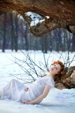 WOman wearing only white dress in the  winter park or forest Royalty Free Stock Photo